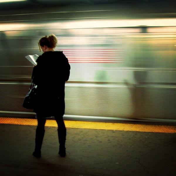 Girl reading on train platform
